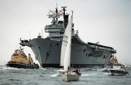 Pictured: The most recent Ark Royal returns in triumph to Portsmouth from her key role in the 2003 Iraq War – her predecessor took part in the Bismarck Action. Photo: Jonathan Eastland/AJAX.