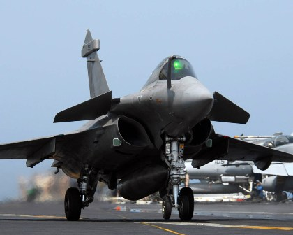 Pictured: A French Navy Rafale strike jet cross-decks on a US Navy carrier in the Arabian Sea. Photo: US Navy.