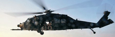 Pictured: A Black Hawk carries US Navy SEALs on a mission. Photo: US DoD.