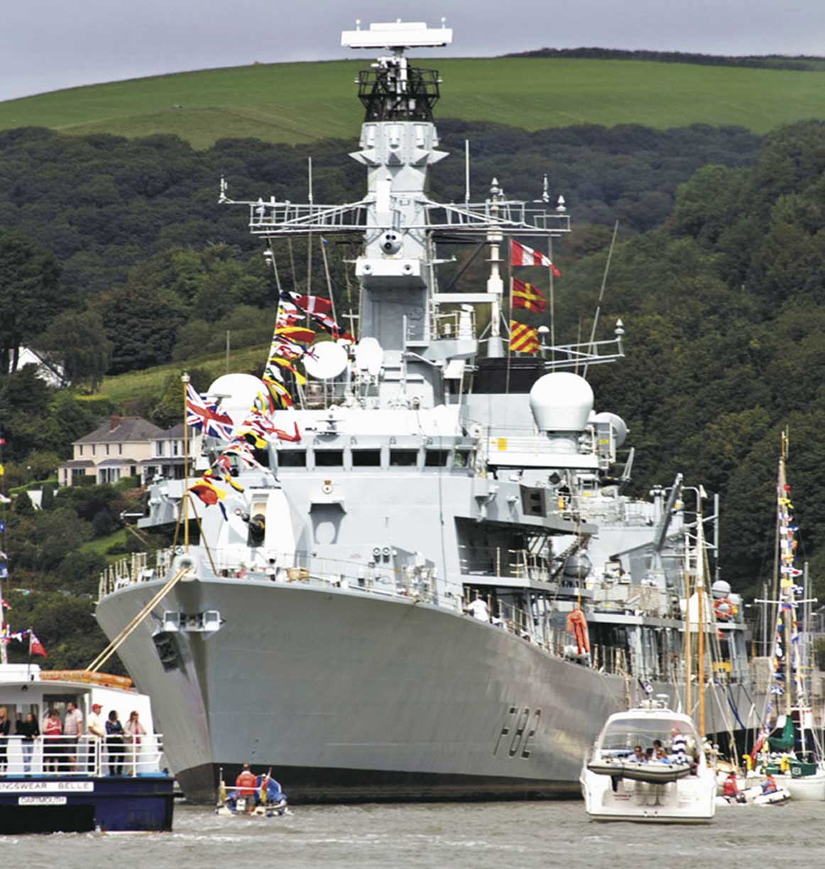 The frigate HMS Somerset showing the flag in home waters. Photo: Nigel Andrews.