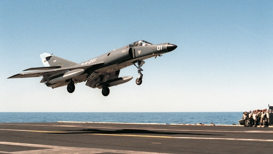 Pictured: An Argentine Navy Super Etendard lands on the USS Abraham Lincoln off the coast of South America. Photo: Tommy Lynaugh/US Navy.