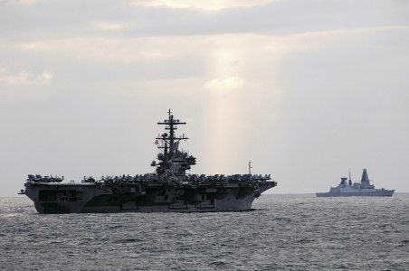 The Royal Navy, out there doing business, out of sight, out of mind? The new Type 45 destroyer HMS Dauntless escorts the Nimitz Class aircraft carrier USS George H.W. Bush during an exercise off the UK. Photo: Deven B.King/US Navy.