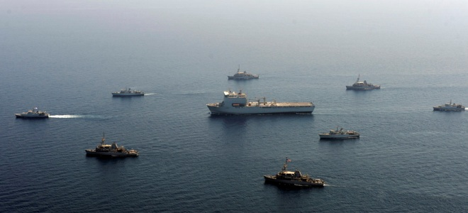 British and US Navy Mine Counter-Measures Vessels (MCMVs) surround the Royal Fleet Auxiliary landing dock ship RFA Lyme Bay during the sort of over-the-horizon, East of Suez trade protection exercise UK citizens rarely notice. Photo: Cassandra Thompson/US Navy.