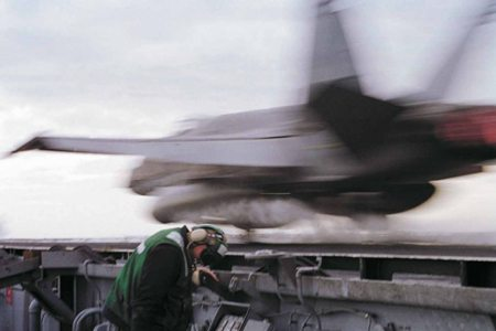 Pictured: In early 1999, as tensions rise in the Balkans an F-18 Hornet is launched from the USS Enterprise. Photo: Michael W. Pendergrass/USN.
