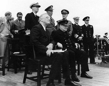 Pictured: President Roosevelt and Prime Minister Churchill aboard HMS Prince of Wales during the Atlantic Charter talks. Photo: USNH&HC